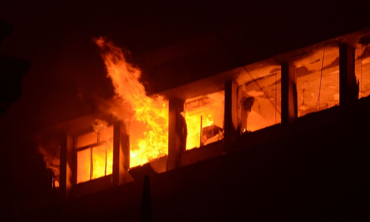 A view of the fire broke out on the 13th floor of the multi-storeyed New Koilaghat Building, housing offices of the Railways, on Strand Road in Kolkata on March 8, 2021.
