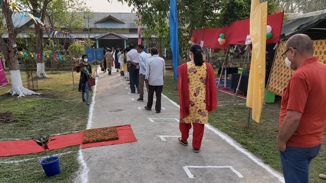 Voters at a polling booth in Assam, in the first phase of voting in the 2021 Assembly elections, on March 27, 2021.
