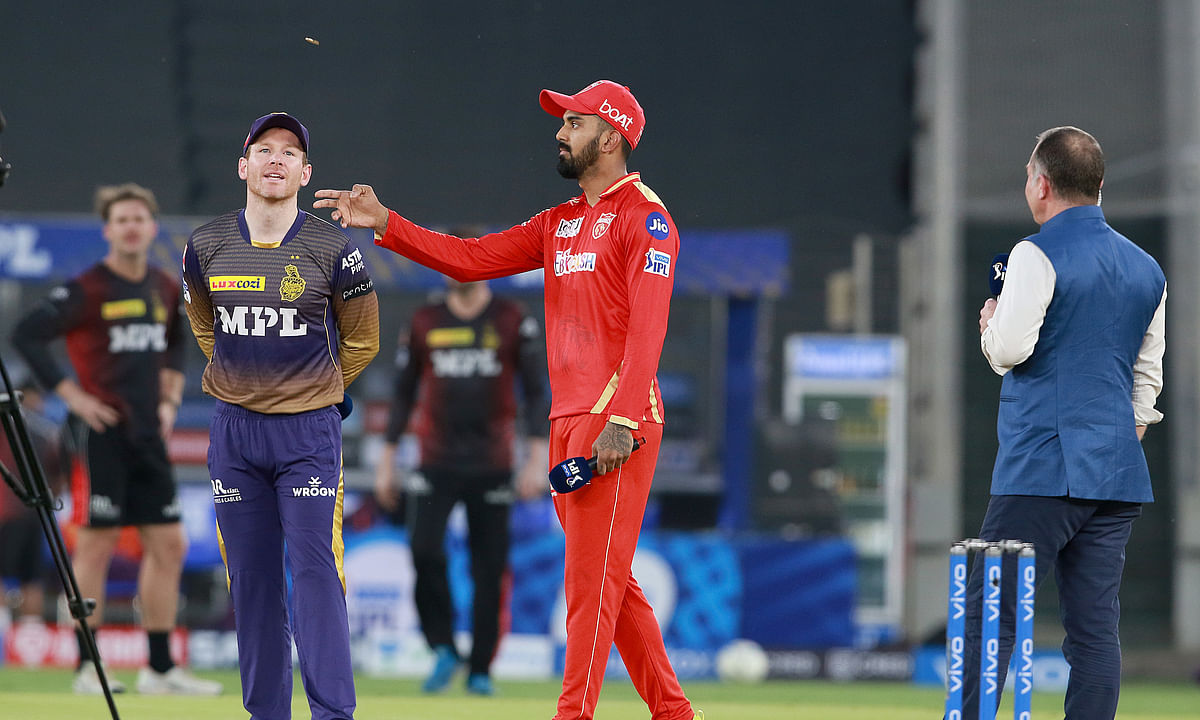 Kolkata Knight Riders skipper Eoin Morgan and Punjab Kings captain K L Rahul at the toss ahead of their match in the Vivo Indian Premier League in Ahmedabad on April 26, 2021.