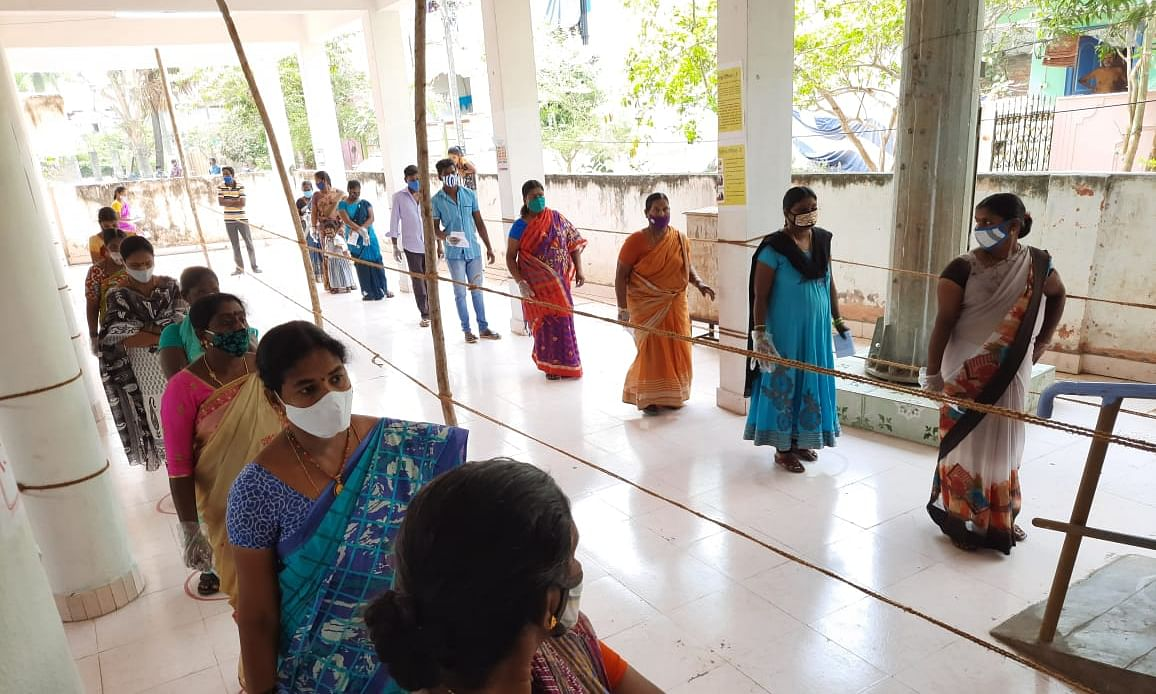Voters queueing up at a polling station in the constituency of Yanam, an enclave of the Union Territory of Puducherry, geographically located in the East Godavari District of Andhra Pradesh, on April 6, 2021.