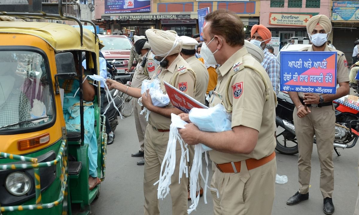 Police personnel carrying out an awareness campaign against the spread of COVID-19, in Amritsar, Punjab on April 5, 2021.