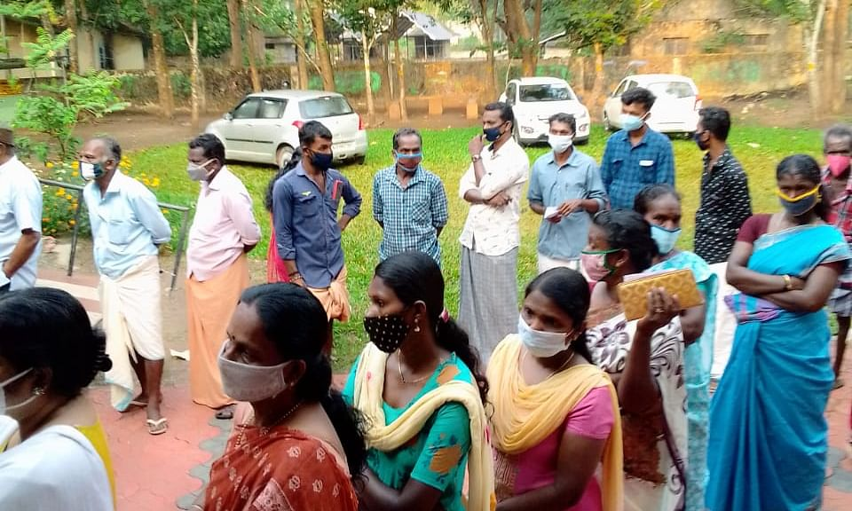 Voters waiting in queues at a polling station at Kulathoopuzha in Kollam district of Kerala, in the elections to the State Legislative Assembly, on April 6, 2021.