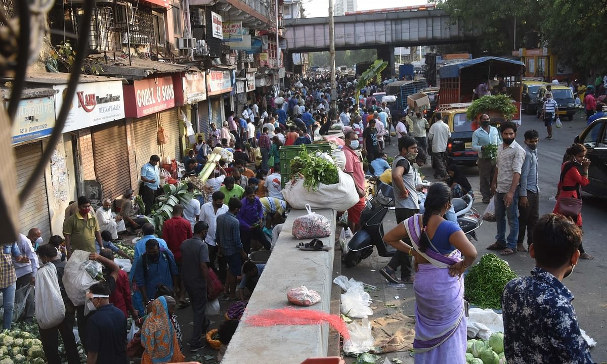 The rush at a vegetable market in Dadar, Mumbai ahead of a weekend lockdown announced by the State government, on April 4, 2021.