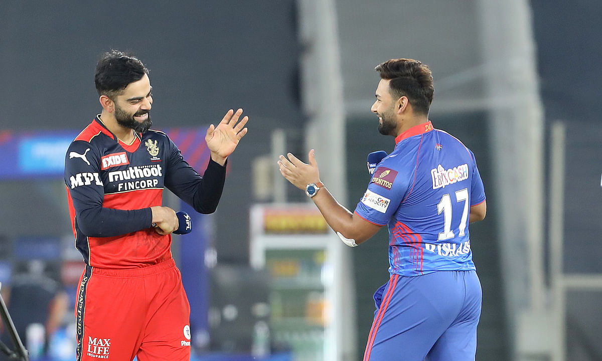 Royal Challengers Bangalore captain Virat Kohli and Delhi Capitals skipper Rishabh Pant at the toss before their match in the Indian Premier League  at the Narendra Modi Stadium in Ahmedabad on April 27, 2021