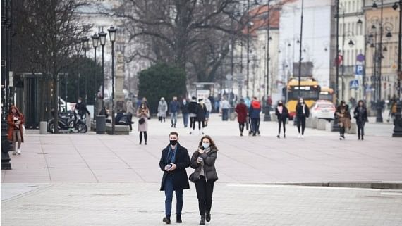 People wearing face masks seen in the Old Town in Warsaw, Poland, on March 30, 2021.