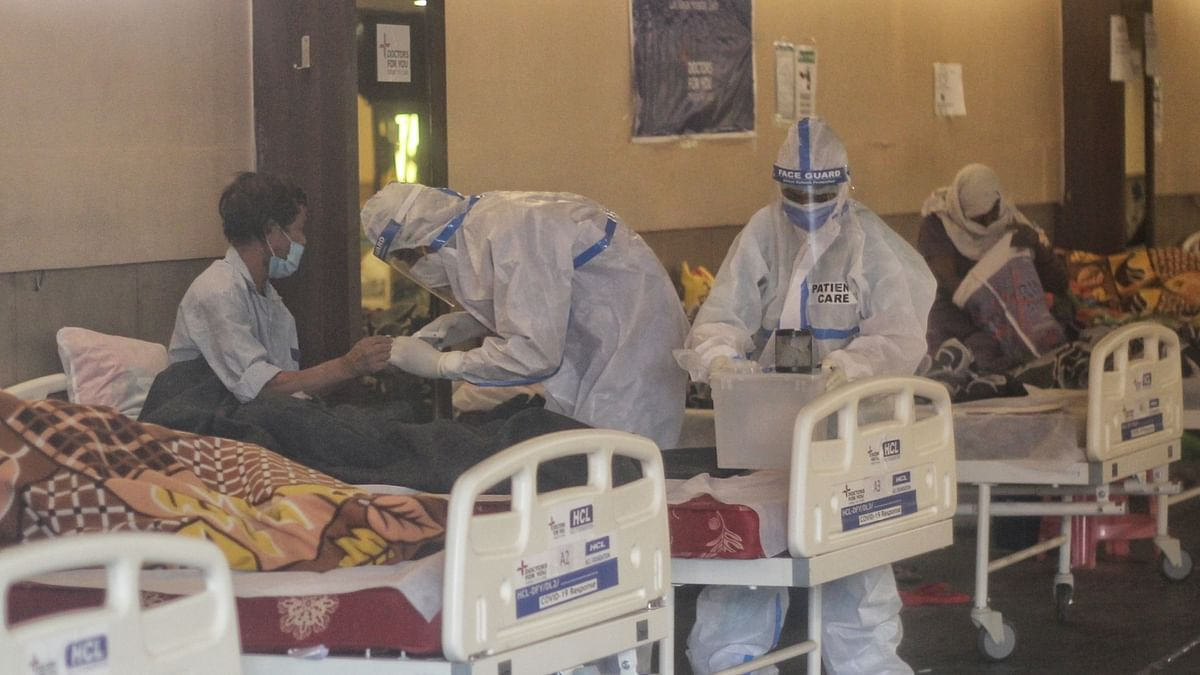 India logs 879 COVID-19 deaths, 161,736 cases of infection in 24 hours