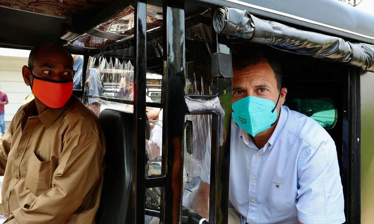 Congress leader Rahul Gandhi travelling in an autorikshaw to reach the venue of his public meeting at Nemom, Thiruvananthapuram in  Kerala, on April 4, 2021.