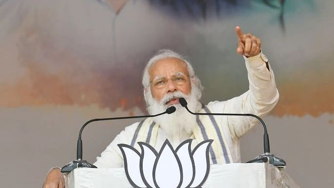 Modi slams both Left and Congress, seeks vote for BJP