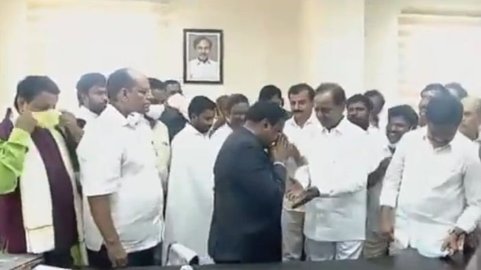 Collector draws ire for touching Telangana CM's feet