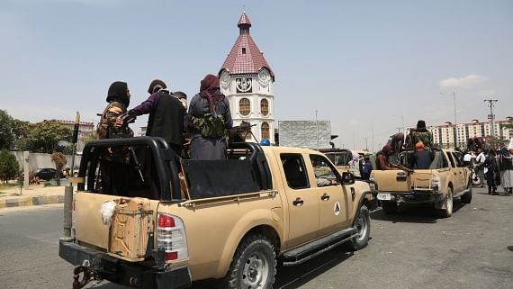 Taliban flag torn down in first signal of popular opposition