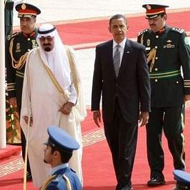 King Abdullah of Saudi Arabia, left, welcomes U.S. President Barack Obama, right, on his arrival at the Royal Terminal of the King Khalid International Airport, in Riyadh, Saudi Arabia.