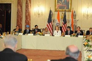 Finance Minister Pranab Mukherjee, Commerce and Industry Minister Anand Sharma and US Secretary of State Hillary Clinton at the US INDIA CEOs Forum Meeting in Washington, DC on June 22, 2010. Also seen is Montek Singh Ahluwalia, Deputy Chairman, Planning Commission.