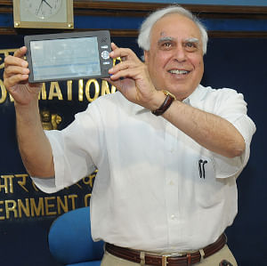 Union Minister for Human Resource Development Kapil Sibal unveiling a low cost computing-cum-access device, in New Delhi on July 22, 2010.