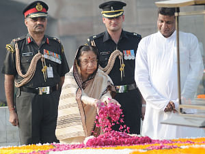 President Pratibha Patil paying floral tributes at the Samadhi of Mahatma Gandhi on his 141st birth anniversary, at Rajghat, in Delhi on October 02, 2010.