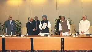 File photo of Prime Minister Singh receiving the Report of the Task Force on Micro, Small and Medium Enterprises from its Chairman and Principal Secretary to Prime Minister, T.K.A. Nair, in New Delhi on January 30, 2010. Then Minister of State of Micro, Small and Medium Enterprises Dinsha J. Patel, the Secretary (MSME) Dinesh Rai and then Finance Secretary Ashok Chawla are also seen.