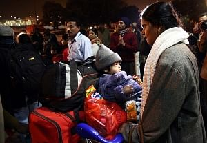 An Indian family after being evacuated on a special flight from Libya, at the International airport in New Delhi, India on 27 February 2011. EPA/UNI PHOTO