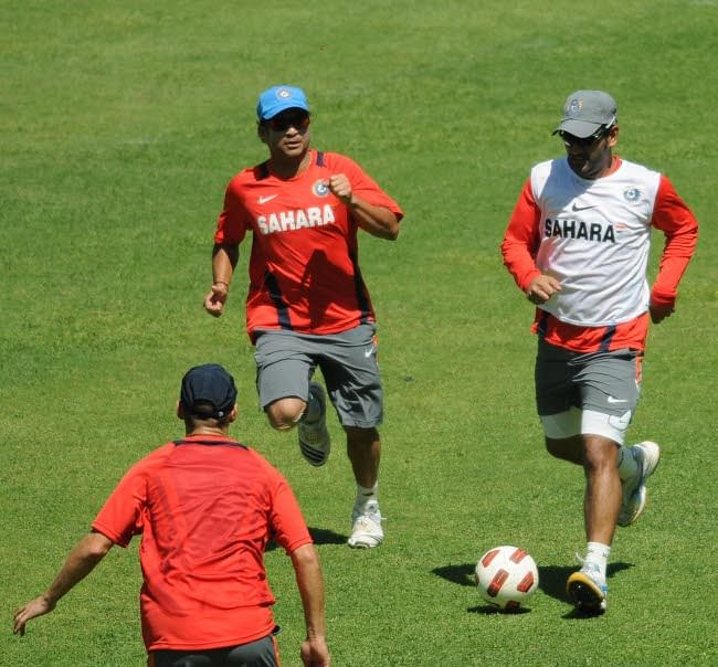 India captain M S Dhoni and Sachin Tendulkar play football during the training session ahead of their ICC World Cup match against Ireland at M Chinnaswamy Stadium in Bangalore on March 3, 2011. UNI PHOTO