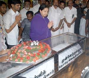 Tamil Nadu Chief Minister J Jayalalithaa paying her last respects to N Mariam Pitchai, newly sworn-in Tamil Nadu Minister for Environment and Pollution Control, who was killed in a road accident, in Tiruchirappalli on Monday. UNI PHOTO