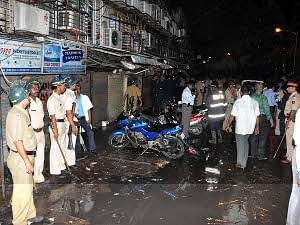 File photo of police at Opera House, one of the three places where serial bomb blasts claimed at least 27 lives and injured more than 130 people in Mumbai on July 13, 2011. UNI PHOTO