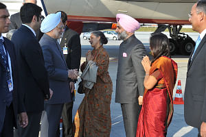 Prime Minister Manmohan Singh being received by Consul General of India Taranjit Singh Sandhu at the Frankfurt International Airport, on his way to New York to attend the 66th Session of the United Nations General Assembly, on September 21, 2011.