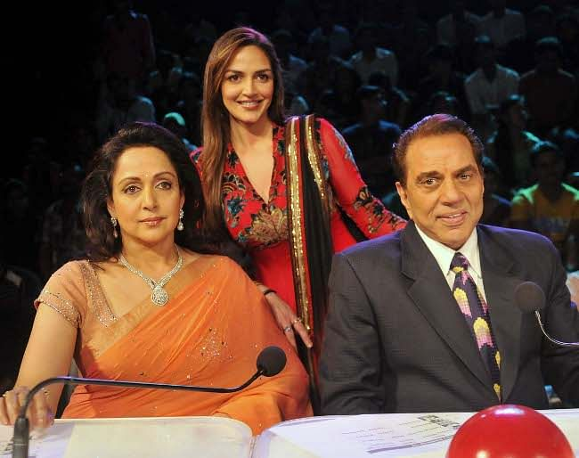 Bollywood actors Dharmendra and Hema Malini with their daughter Esha Deol during the promotion of their film