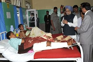 Prime Minister Manmohan Singh enquiring about the health of victims of the September 18 earthquake that hit Sikkim,  in Gangtok, on September 29, 2011.