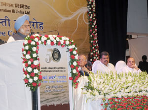 Prime Minister Manmohan Singh addressing the Golden Jubilee celebrations of the Shipping Corporation of India, in Mumbai on October 1, 2011. Maharashtra Governor S. Sankaranarayanan and Union Shipping  Minister G.K. Vasan are also seen.