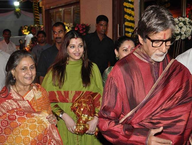 Bollywood actor couple  Amitabh Bachchan and Jaya Bachchan with daughter-in-law and actress Aishwarya Rai Bachchan during the Mata Ki Chowki at actor Sanjay Dutt's residence in Mumbai on the night of October 3, 2011. UNI PHOTO