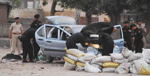 Haryana Police bomb squad inspecting a car on October 13, 2011 from which  about five kg RDX was recovered the previous night. The Indica car had a fake license plate number  HR 03 0054 and was at a  parking lot at the Ambala Cantonment railway station. UNI PHOTO