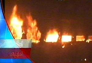 TV grab showing coaches of Howrah-Dehradun express ablaze near Giridih railway station in Jharkhand in the early hours on November 22, 2011. As many as seven passengers were killed and several injured in the fire. UNI PHOTO