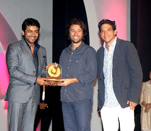 """Actor Surya presenting the award for the Best Film to director Alejandro Landes and producer Franciso Aliure for the film """"Porfirio"""" at the closing ceremony of the 42nd International Film Festival of India at Panaji on December 3, 2011."""