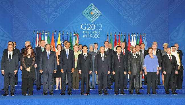 Prime Minister Manmohan Singh in a group photo with the G-20 leaders, at Los Cabos, Mexico on June 18, 2012.