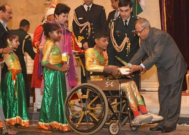 President Pranab Mukherjee interacting with differently-abled children who visited Rashtrapati Bhavan to greet him on his 77th birthday on December 11, 2012.