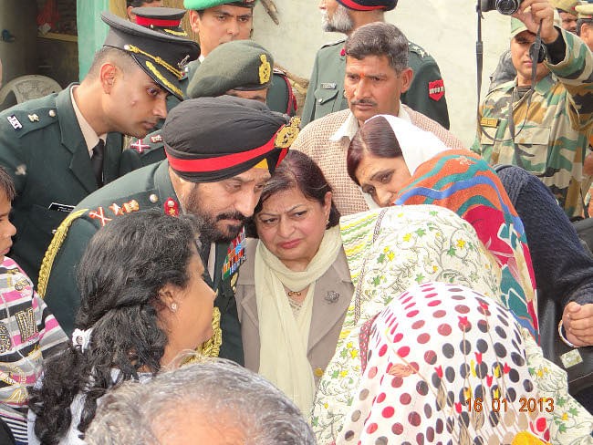 Chief of Army Staff General Bikram Singh and his wife Mrs. Bubbles Singh interact with members of the family of Lance Naik Hemraj, one of the two Indian soldiers killed by Pakistani troops who intruded across the Line of Control in the Mendhar sector on January 8, at village Shernagar, near Mathura on January 16, 2013.