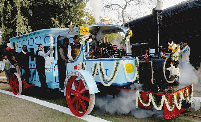 Railway Board Chairman Vinay Mittal dedicates a locomotive and saloon of the Patiala State Mono Rail Tramways, after restoration, to the public, at the National Rail Museum in New Delhi on February 2, 2013.