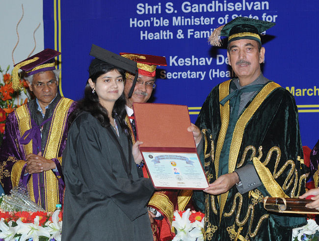 Union Minister for Health and Family Welfare Ghulam Nabi Azad presenting degree to a student, at the Foundation Day Celebrations of the Post Graduate Institute of Medical Education & Research, Dr. RML Hospital, New Delhi, in New Delhi on March 5, 2013.