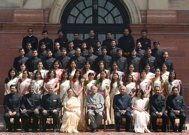 President Pranab Mukherjee with the officer trainees of the 66th batch of Indian Revenue Service from National Academy of Direct Taxes Nagpur, at Rashtrapati Bhavan, in New Delhi on March 18, 2013.