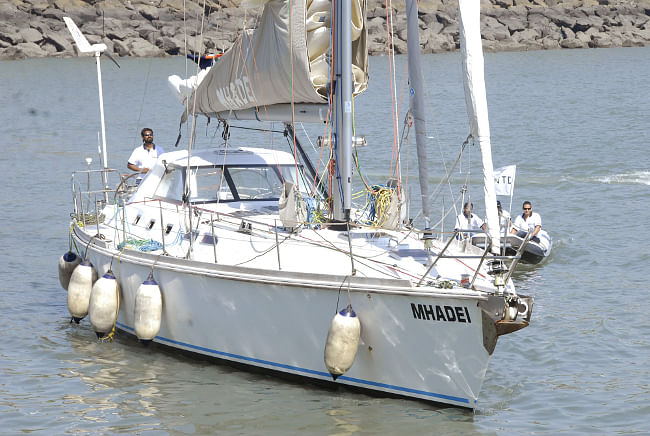 INSV Mhadei, skippered by Lt.Cdr. Abhilash Tomy sails into the Mumbai harbour, after solo, non-stop, voyage round the world, in Mumbai on April 06, 2013