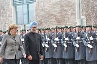Prime Minister Manmohan Singh with German Chancellor Angela Merkel inspecting the Guard of Honour, at the Federal Chancellery, in Berlin on April 11, 2013.