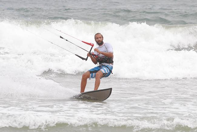 A surfer in action on the final day of the National Surfing and Stand Up Paddle (SUP) competition at Kovalam in Kerala on May 5, 2013.