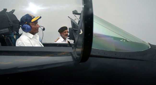 Defence Minister A. K. Antony pilots a 25-minute flight of an MiG-29K on the state-of-the-art simulator at INS Hansa, in Goa on May 11, 2013.