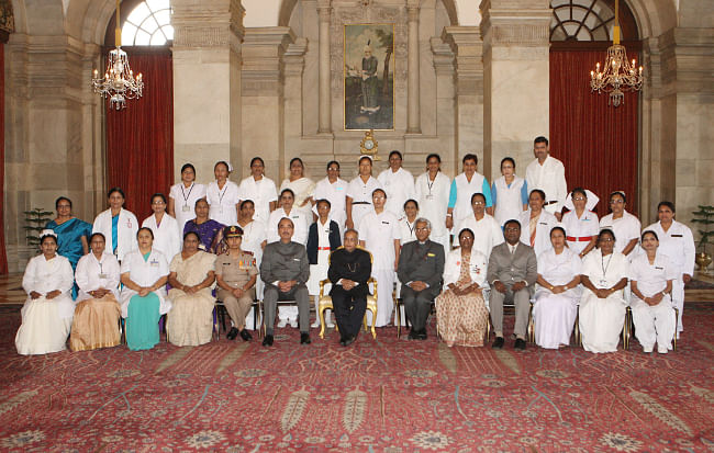 President Pranab Mukherjee with nurses who won the Florence Nightingale Awards 2013 at Rashtrapati Bhavan in New Delhi on May 12, 2013.