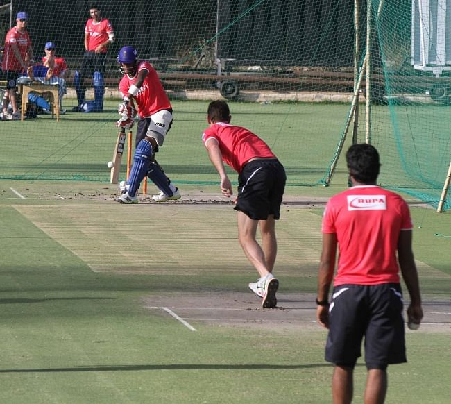 Rajasthan Royals' Shaun Tait bowls to Kevon Cooper during a practice session at Sawai Mansingh Stadium in Jaipur on May 19, 2013.
