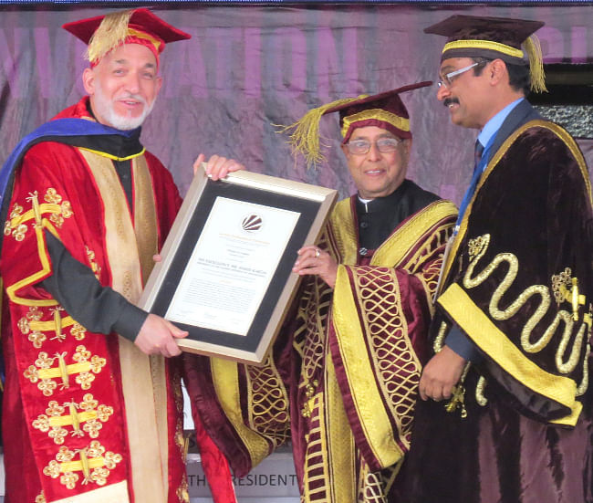 President Pranab Mukherjee awarding the Lovely Professional University' first honorary doctorate degree to Afghanistan President Hamid Karzai, at the 3rd convocation of the university at Jalandhar on May 20, 2013.