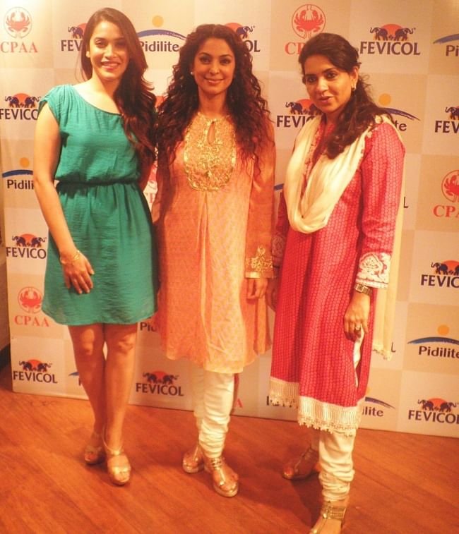 Actresses Rashmi Nigam and Juhi Chawla with designer Shaina NC, in Mumbai on May 28, 2013, ahead of a fashion show to raise funds for cancer patients on June 2, 2013.