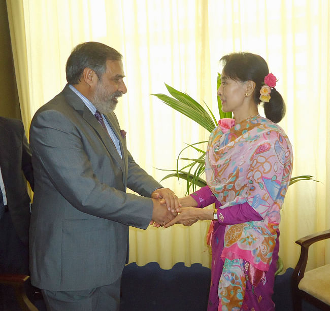 Union Minister for Commerce & Industry Anand Sharma meeting National League for Democracy chairperson Aung San Suu Kyi on the sidelines of the World Economic Forum on East Asia, at Nay Pyi Taw in Myanmar on June 6, 2013.