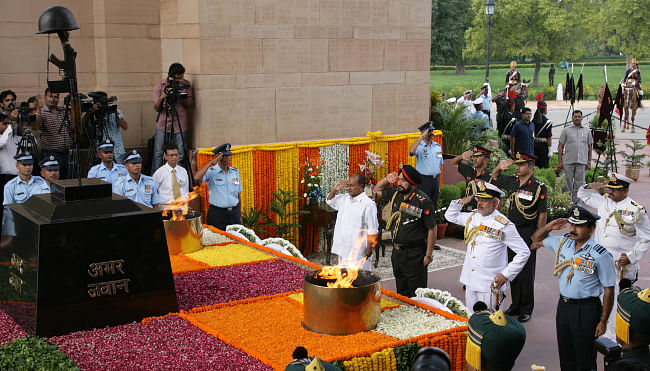 Defence Minister A. K. Antony, Chief of Army Staff, General Bikram Singh, Chief of Naval Staff  Admiral D.K. Joshi and Vice Chief of Air Staff Air Marshal Arup Raha laid wreaths at Amar Jawan Jyoti, on the occasion of Kargil Vijay Diwas, in New Delhi on July 26, 2013.