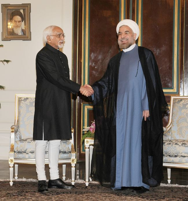 Vice-President M Hamid Ansari meeting the new President of Iran, Dr. Hassan Rouhani, at Sa'dabad Palace, in Tehran, Iran on August 4, 2013.