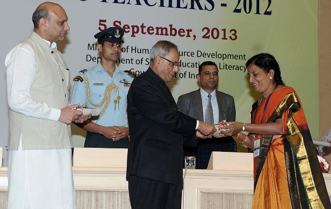 President Pranab Mukherjee presenting the National Award for Teachers-2012 to Ms R. Shivamma of Kerala on the occasion of Teachers Day in New Delhi on September 5, 2013.