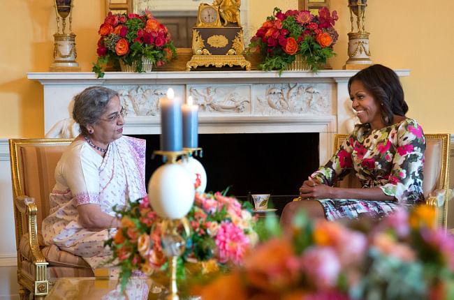 US First Lady Michelle Obama hosts tea for Mrs Gursharan Kaur, wife of Prime Minister Manmohan Singh, in the Yellow Oval Room of the White House, on September 27, 2013. Official White House Photo by Amanda Lucidon.